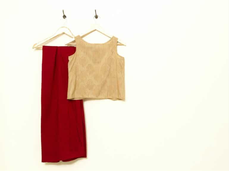 Indian ethnic hand printed, natural jute-silk crop top; sleeveless with a centre back hook and eye placket. Paired with semi-raw silk palazzos