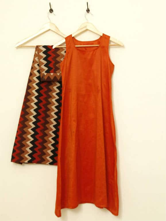 Solid, flared Semi-raw silk, sleeveless tunic, with an asymmetrical hemline