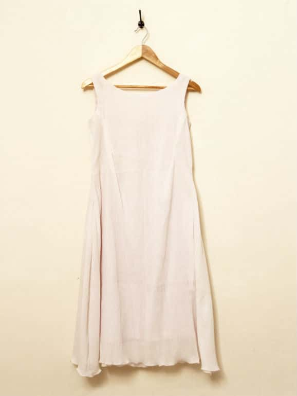 Sleeveless cotton tunic, flared with inverted pleat till waist