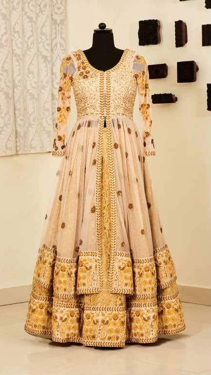 Bridal Lehenga set, hand embroidered with motifs of flowers, peacocks and wines with stones, beads, zardozi and thread on soft net and raw silk