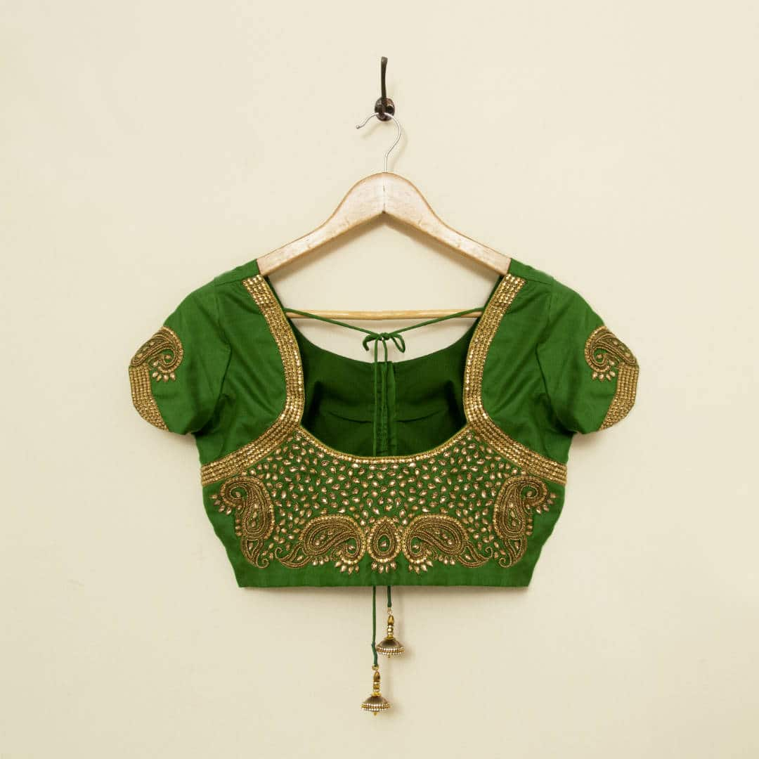 Hand embroidered pure silk blouse with stone work and paisley motifs, tailored for a wedding reception