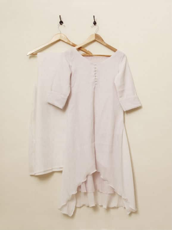 Asymmetric cotton tunic with front button and loop placket. Paired with palazzos