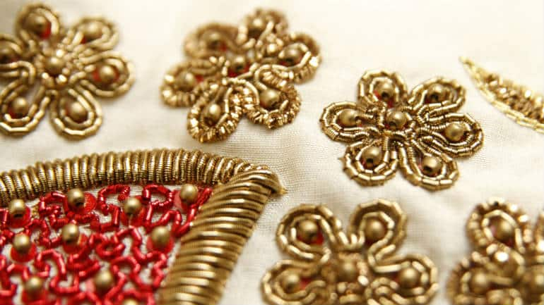 Hand embroidered floral motifs with zardozi and beads on pure silk
