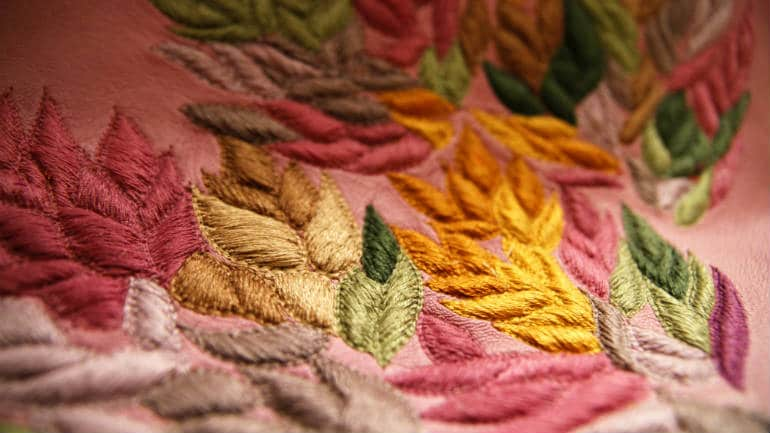 Multicoloured, embossed thread-work embroidery on leather