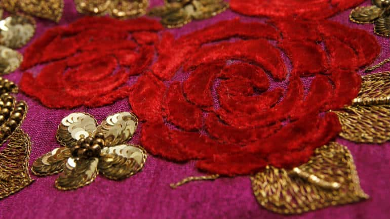 Applique work, combined with sequin, bead and chain embroidery on raw silk