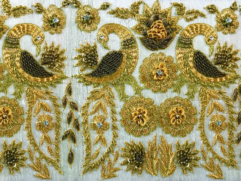 A fusion of intricate thread work, zardozi, bead and stone work on raw silk