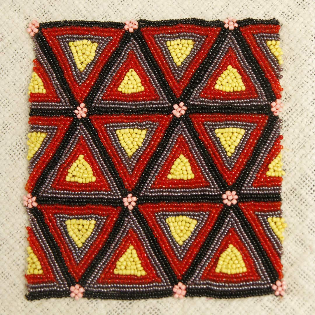 Heavy bead embroidery on soft net