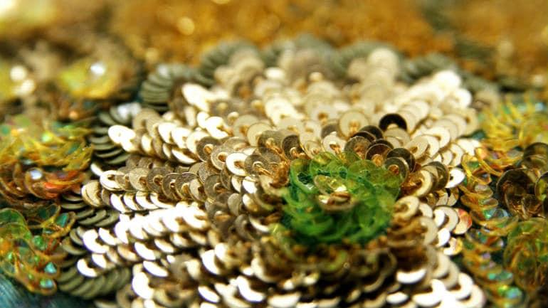 Multi-coloured, three-dimensional floral motifs on pure silk