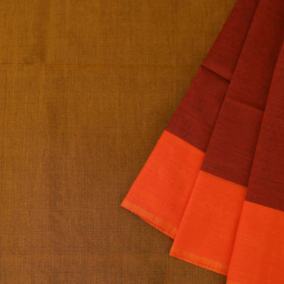 Plain Handwoven silk-cotton saree with a contrasting border and pallu