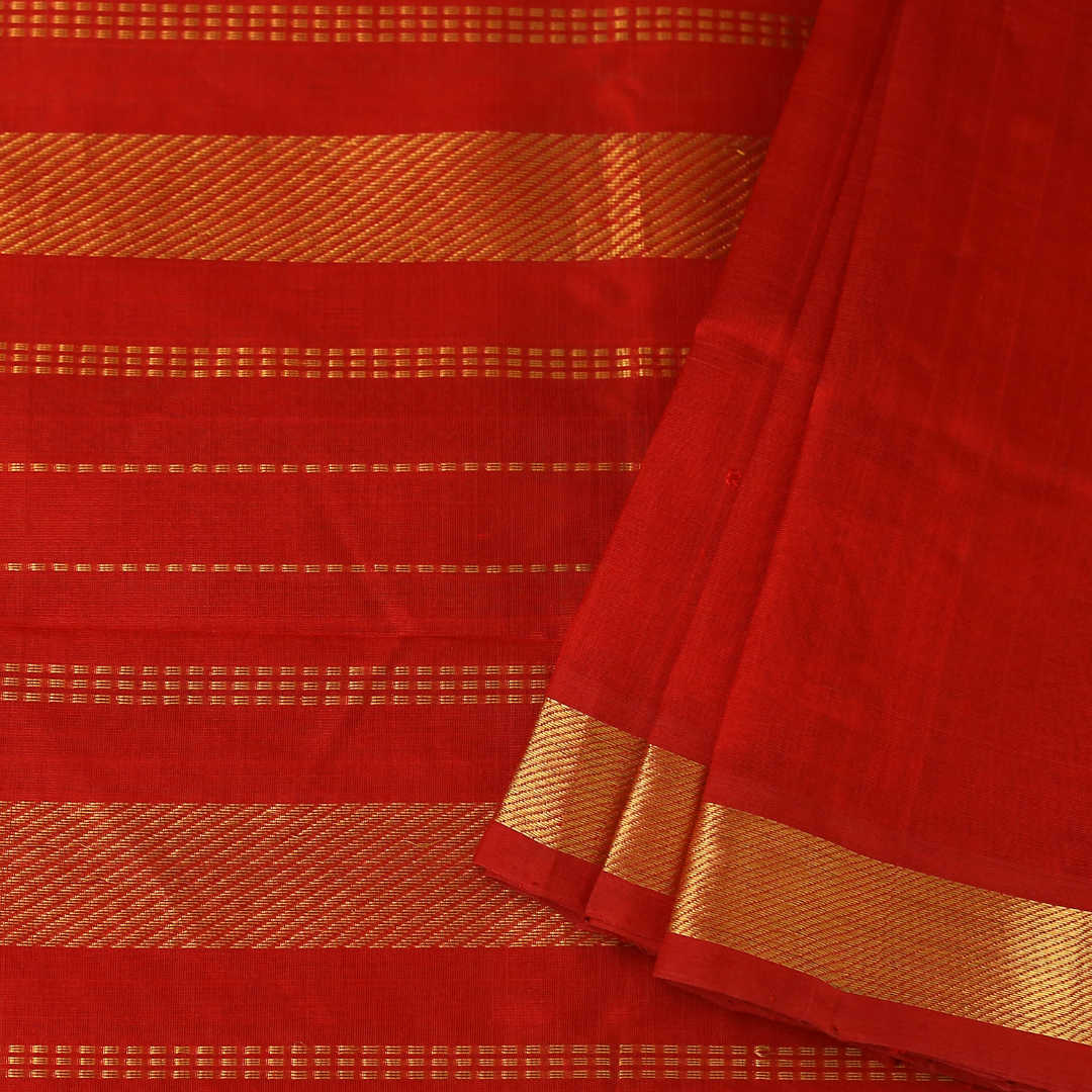 Solid red handwoven silk-cotton saree with zari, best paired with a contrasting blouse