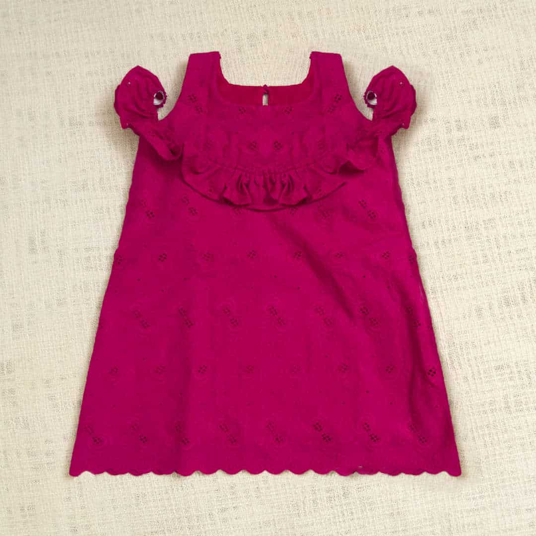 Hakoba cotton dress with frill details along the top yoke and a cold shoulder