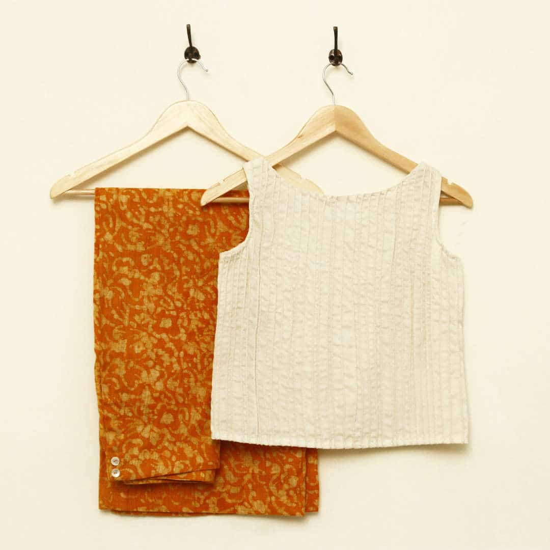 Handwoven modal-silk crop top, with unequal corded pin-tucks all over. Paired with batik printed jute palazzos