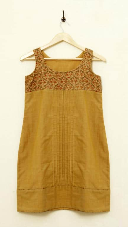 Handwoven banana-silk and cotton tunic with printed yoke, corded pin-tucks on cotton and a piping edged border at the bottom. The top yoke and piping around border are of Kalamkari Banana-silk fabric, hand printed with organic dyes.